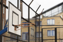 Basketball hoop and backboard in a residential estate Stock Photos