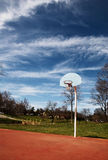 Basketball hoop basket on court. Basketball hoop on a red court at a park royalty free stock photo