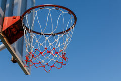 Basketball hoop with blue sky. Royalty Free Stock Photography