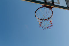 Basketball hoop with blue sky. Royalty Free Stock Images