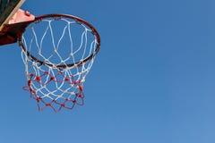 Basketball hoop with blue sky Stock Photos