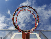 Basketball hoop on blue sky and clouds Royalty Free Stock Image