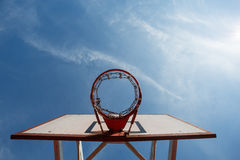Basketball hoop in blue sky Royalty Free Stock Photography