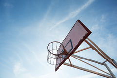 Basketball hoop in blue sky Royalty Free Stock Photo