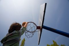 Basketball hoop and boy score Stock Photography