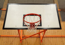 Basketball hoop cage in public gym Stock Images