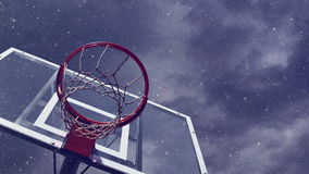 Basketball hoop with cage with snowfall stock video footage