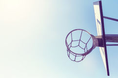 Basketball hoop with chain net at sunset. Royalty Free Stock Image