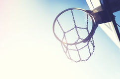 Basketball hoop with chain net at sunset. Royalty Free Stock Photography