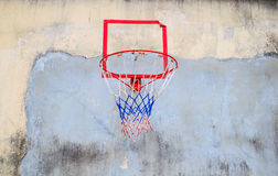 Basketball hoop cling to old wall of house Stock Image