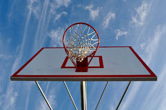 Basketball Hoop with Clouds and Blue Sky Stock Images