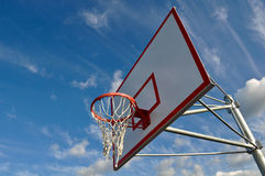 Basketball Hoop with Clouds and Blue Sky Royalty Free Stock Photography