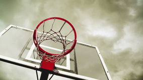 Basketball hoop with clouds time lapse footage in background. Royalty Free Stock Photos