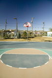 Basketball hoop and court in El Paso Texas looking toward Juarez, Mexico Royalty Free Stock Images