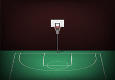 Basketball hoop on empty green court Stock Photos