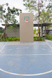 Basketball hoop on empty outdoor court Stock Photo