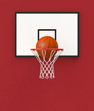 Basketball hoop. Front view of a basketball hoop and a ball falling through the hoop (3d render Royalty Free Stock Images