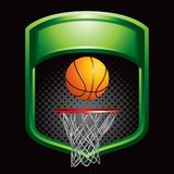Basketball and hoop on green display Stock Photos