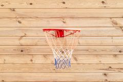 Basketball hoop hanged on wooden board background. Playground on backyard of home. Sport equipment for children. Outdoor net fun game recreation court circle stock photo