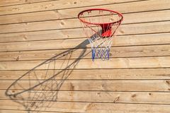 Basketball hoop hanged on wooden board background. Playground on backyard of home. Sport equipment for children. Outdoor net fun game recreation court circle stock photography