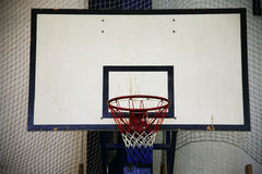 Basketball hoop in a high school gym Royalty Free Stock Photo