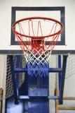 Basketball hoop in a high school gym Royalty Free Stock Photos