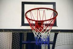 Basketball hoop in a high school gym Stock Image
