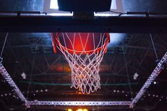 Basketball Hoop In Red Neon Lights In Sports Arena During Game Stock Images