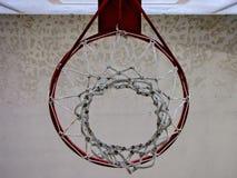 Basketball hoop indoor court from below Stock Image