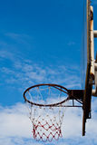 Basketball hoop at its backboard against blue sky. In afternoon Stock Images