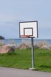Basketball hoop near sea coast Stock Images