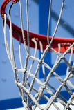 Basketball Hoop and Net. Closeup detail of a playground basketball goal and net. Shallow depth of field Royalty Free Stock Image