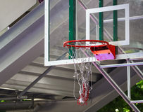 Basketball hoop with net damaged. Red Basketball hoop with net damaged Royalty Free Stock Images
