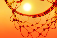Basketball hoop outdoor in the sunset, Colorful and vibrant Royalty Free Stock Photo