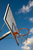 Basketball hoop over blue sky Stock Image