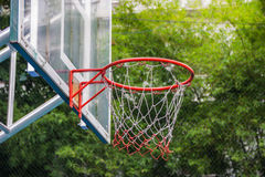 Basketball hoop in the park. With green trees as background Royalty Free Stock Photography
