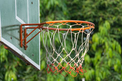 Basketball hoop in park. Basketball hoop make by wooden and ball in park Stock Photography