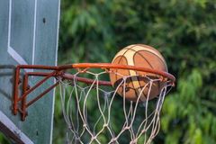 Basketball hoop in park. Basketball hoop make by wooden and ball in park Stock Images