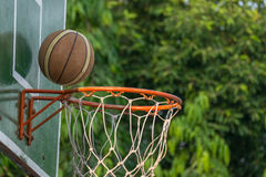 Basketball hoop in park. Basketball hoop make by wooden and ball in park Royalty Free Stock Image