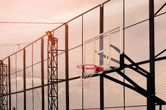 Basketball hoop. On playground at evening, vintage style stock images