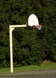 Basketball hoop and pole. Basketball hoop with no players around Royalty Free Stock Image