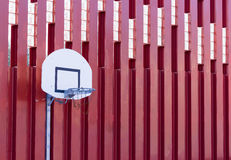 Basketball hoop on red metallic wall structure Stock Photos