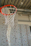 Basketball hoop and rock-climbing wall Royalty Free Stock Photography