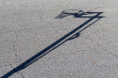 Basketball Hoop Shadow. Shadow of a basketball hoop on asphalt Royalty Free Stock Photo