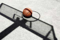 Basketball and hoop shadow Stock Photos