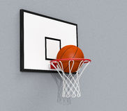 Basketball hoop. Side view of a basketball hoop and a ball falling through the hoop (3d render Royalty Free Stock Photo