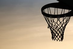 Basketball hoop silhouette in the sunset. cirrostratus clouds ba. Basketball hoop silhouette with mesh in the sunset. cirrostratus clouds background stock photos