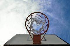 Basketball. Hoop and sky background Stock Photos