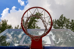 Basketball hoop on sky. Trees, nature Royalty Free Stock Photography