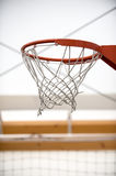 Basketball hoop in sport school gym hall Stock Images